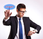 Checking time and pressing start button — Stock Photo
