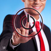 Business man pressing ON OFF button — Stockfoto