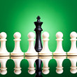 Royalty-Free Stock Photo: White pawns in front of a black king