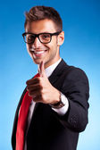Business man shows thumbs up ok gesture — Stock Photo