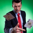 Young business man throwing the winning hand — Stock Photo