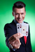 Business man holding a pair of aces — Stock Photo