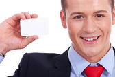 Business man showing a blank business card — Stock Photo