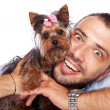 Young man holding a cute yorkie puppy dog — Stock Photo