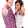 Couple showing thumbs up sign — Stock Photo #12396390
