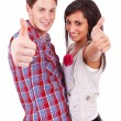 Couple showing thumbs up sign — Stock Photo