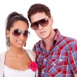 Stock Photo: Young couple wearing sunglasses
