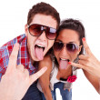 Party couple screaming with tongues out - Stock Photo