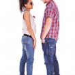 Cute casual couple standing face to face — Stock Photo #12396435
