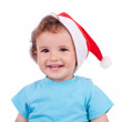 Lovely boy with a christmas cap and smiling — Stock Photo