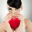 Attractive young woman model holding a heart — Stock Photo #12396529