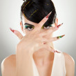 Stock Photo: Young woman covering her face with her hand