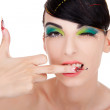 Model with long fancy nails showing middle finger — Stock Photo