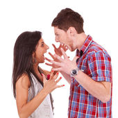 Young couple screaming violently at eachother — Stock Photo