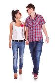 Casual couple walking towards the camera — Stock Photo