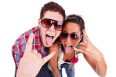 Party couple screaming with tongues out — Stockfoto