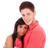 Young freckled man holding his girlfriend — Stock Photo