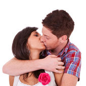 A young couple kissing — Stock Photo