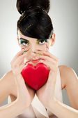 Attractive young woman model holding a heart — Stock Photo