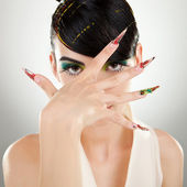 Young woman covering her face with her hand — Stockfoto