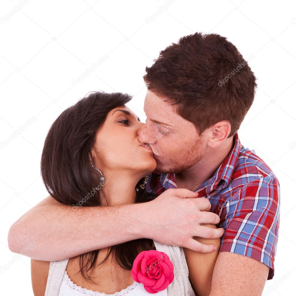 A portrait of a young couple kissing, over white background — Stock Photo #12396468