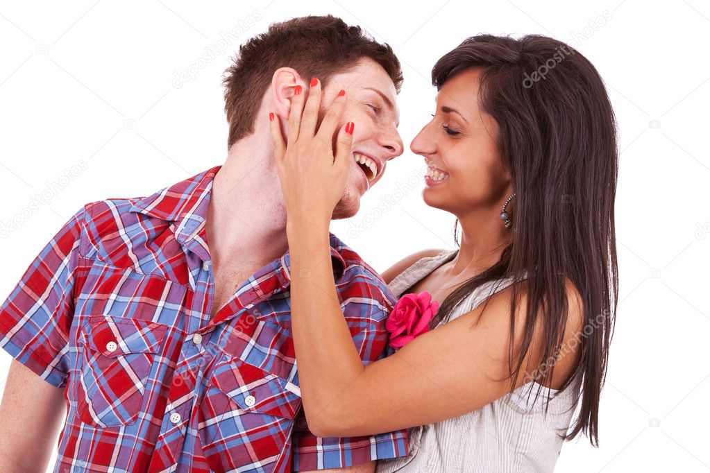 Sweet young couple preparing to kiss. Girl is caressing his face and they are both smiling — Stock Photo #12396495