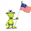 Photo: Cute cartoon monster holding an American flag.