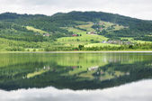 Calm lake reflection — Stock Photo