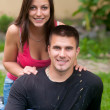 Beautiful young happy couple having fun in the grass — Stock Photo