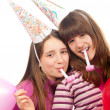 Royalty-Free Stock Photo: Two beautiful teenage girls celebrating isolated on white