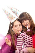 Two beautiful teenage girls celebrating isolated on white — Stock Photo