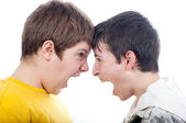 Two teenage boys screaming at each other isolated on white — Stock Photo