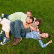 Royalty-Free Stock Photo: Happy teenage friends having fun in the grass