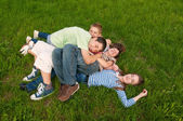 Happy teenage friends having fun in the grass — Stock Photo