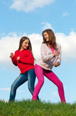 Two teenage girls having fun outdoor on sunny spring day — Stock Photo