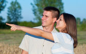 Young couple in the nature on sunny summer day — Stock Photo
