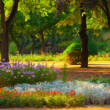 Stock Photo: Landscape painting showing blooming of flowers in park in spring
