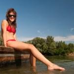 Beautiful teenage girl sunbathing on the boat on sunny summer day — Stock Photo