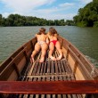 Stock Photo: Cute teenage girls sunbathing in boat on sunny summer day