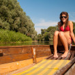 Cute teenage girl sunbathing on the boat on sunny summer day — Stock Photo