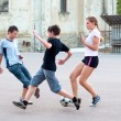 Teenage boys and girls playing soccer on the playground — Stock Photo