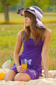 Cute teenage girl on the picnic on sunny summer day — Stock Photo