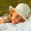 Cute little girl rests her head in her mothers lap on sunny summer day - 