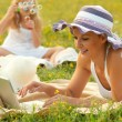 Mother and daughter having fun in the nature on sunny summer day - 