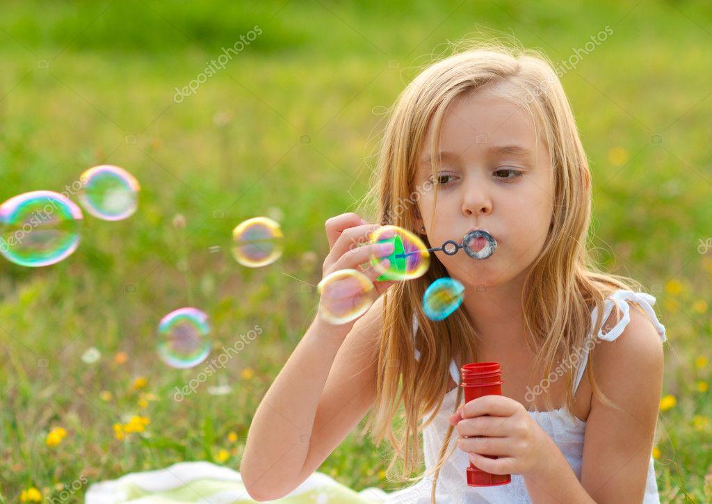 Girl Blowing Soap Bubbles Cute Little Girl Blowing Soap
