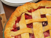 Fresh Baked Three-Berry Pie with Lattice Crust with Plates and Knife — Stock Photo