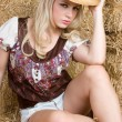 Pretty country girl wearing hat — Stock Photo