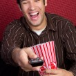 Popcorn Man Watching TV - Foto Stock