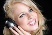 Blond Girl Wearing Headphones — Stock Photo