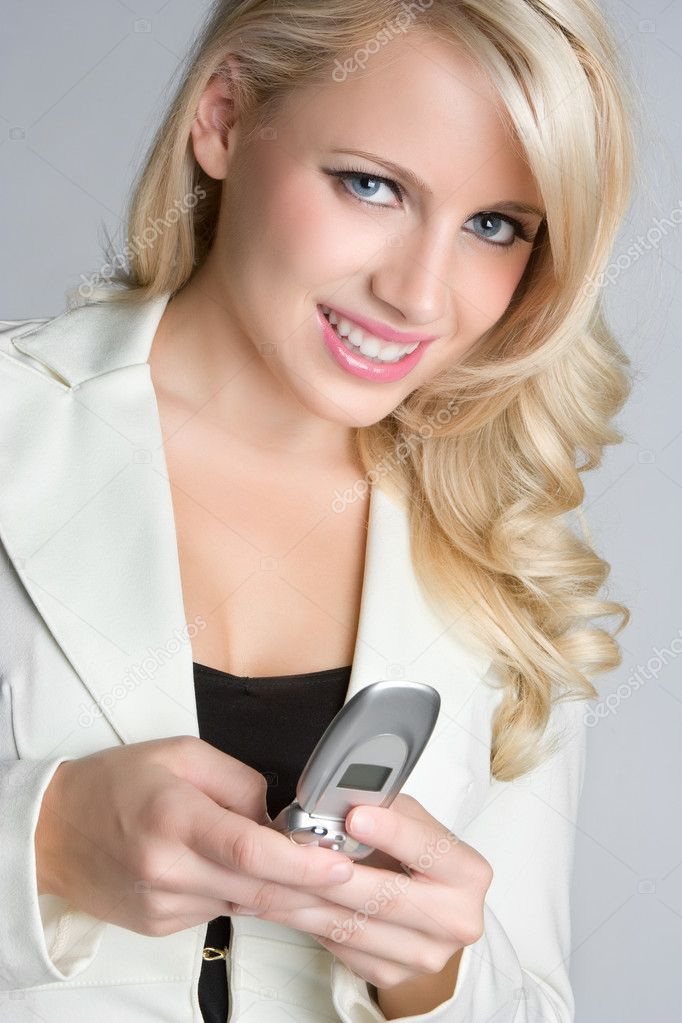 Blond Businesswoman Text Messaging  Stock Photo #11003193